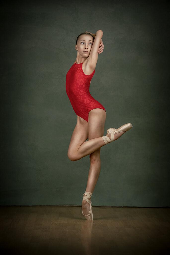 girl dancing in red leotard