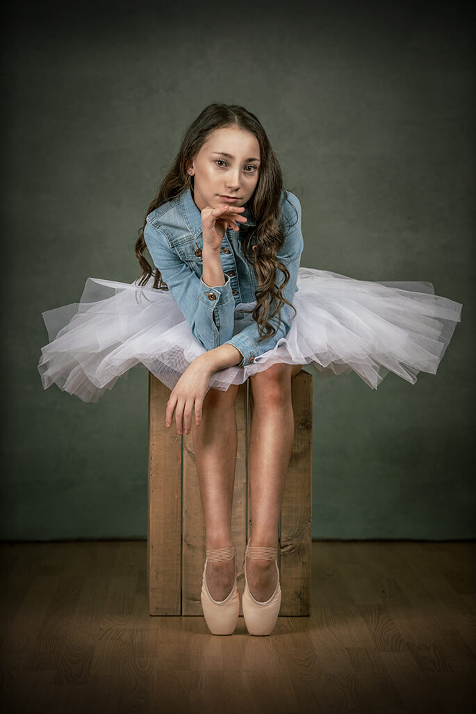 girl dancing in tutu and denim jacket