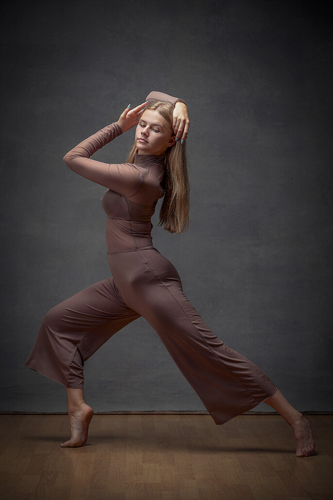 girl dancing in brown outfit