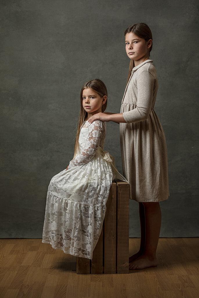 sisters in vintage dresses