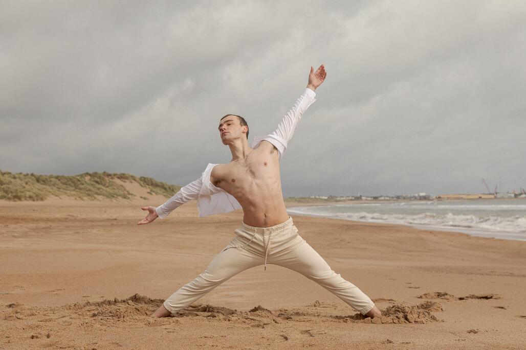 Male ballet dancer at beach