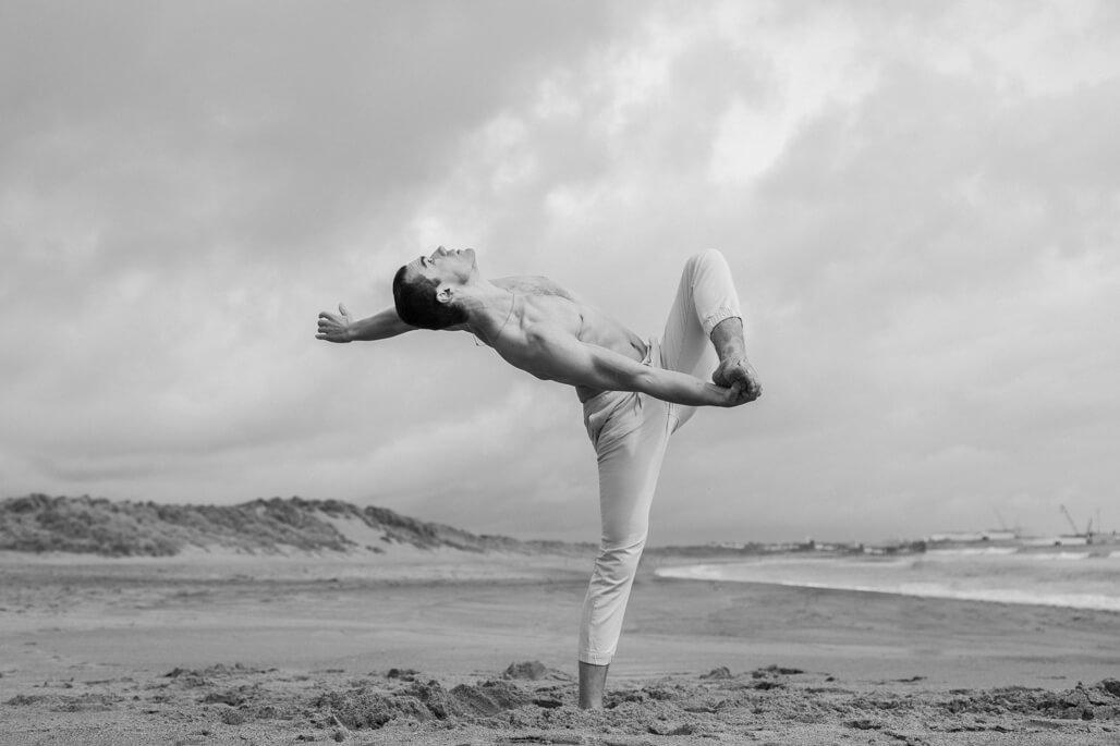 Male ballet dancer on the beach