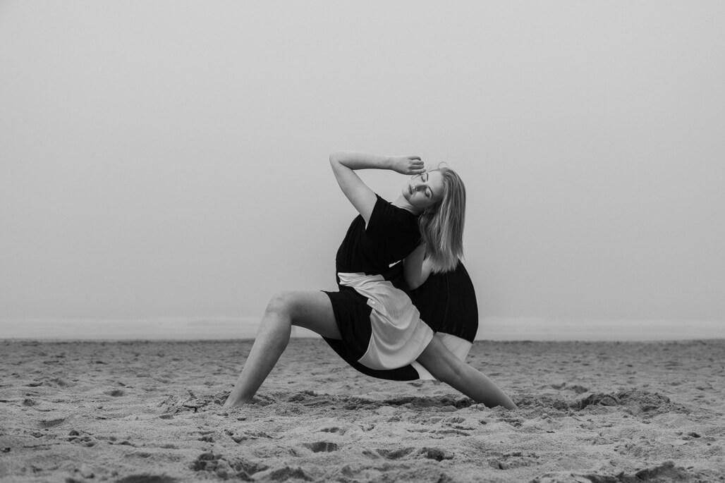 Female show dancer on the beach