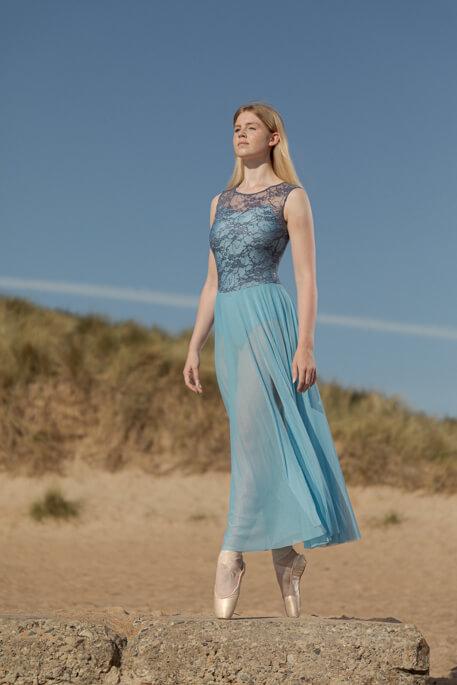 girl on plinth in blue ballet dress