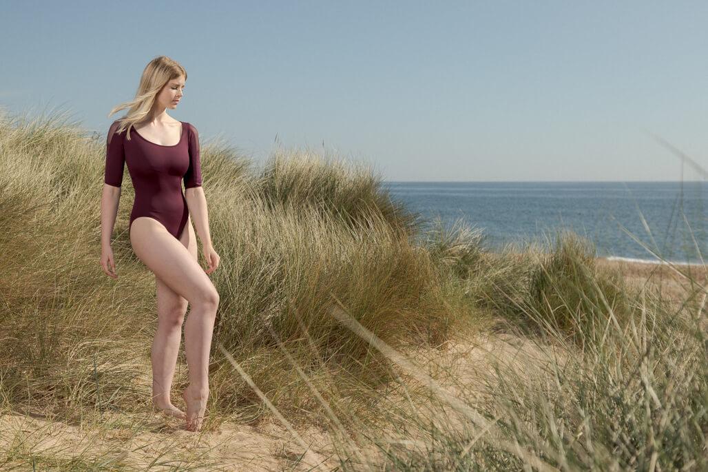 girl in Burgundy leotard on beach